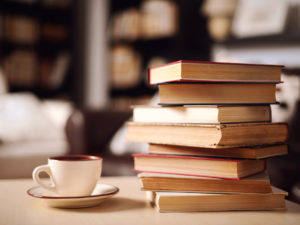 stack of books and coffee at one of the best bookstores in Carbondale
