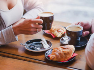 couple enjoying coffee and pastries at Longbranch Cafe and Bakery