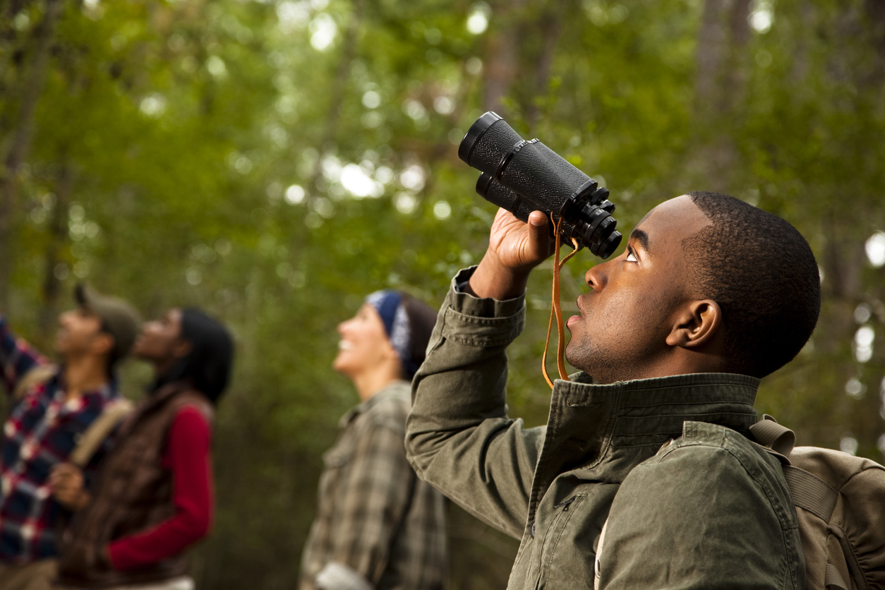 group of friends bird watching at Brush Hill Nature Preserve