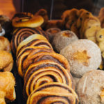 A variety of cakes and pastries on a boulangerie or patisserie market stall.